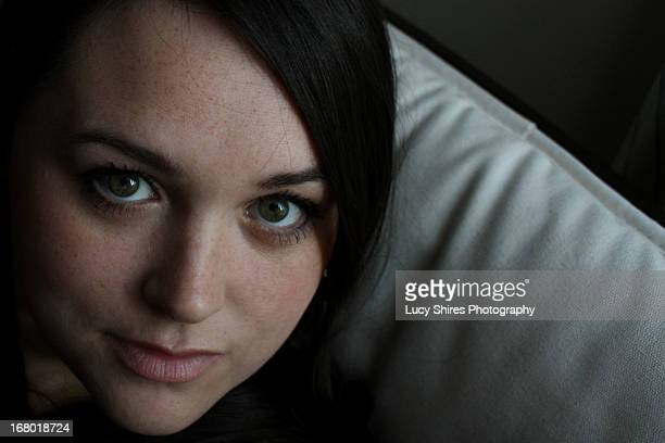 dark haired female portrait of face - lucy shires stock pictures, royalty-free photos & images