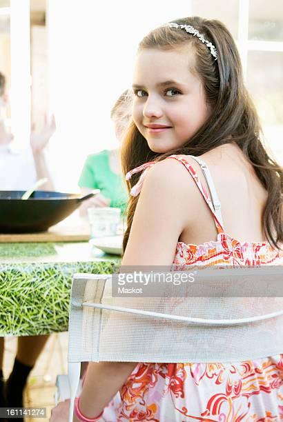 Dark haired girl in summerdress