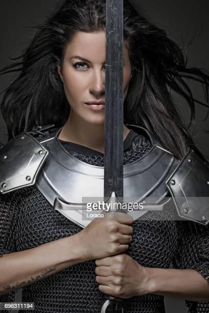 dark haired viking woman in studio setting - mulher guerreira imagens e fotografias de stock