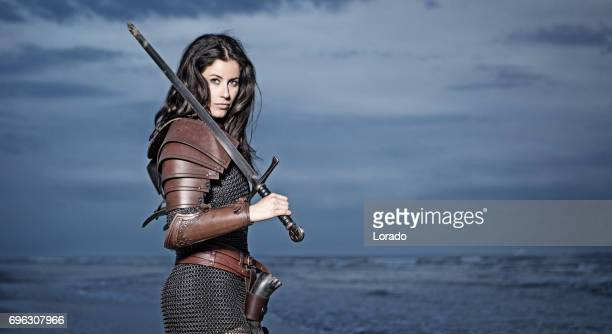 Dark Haired Viking Woman in the Sea at Dusk