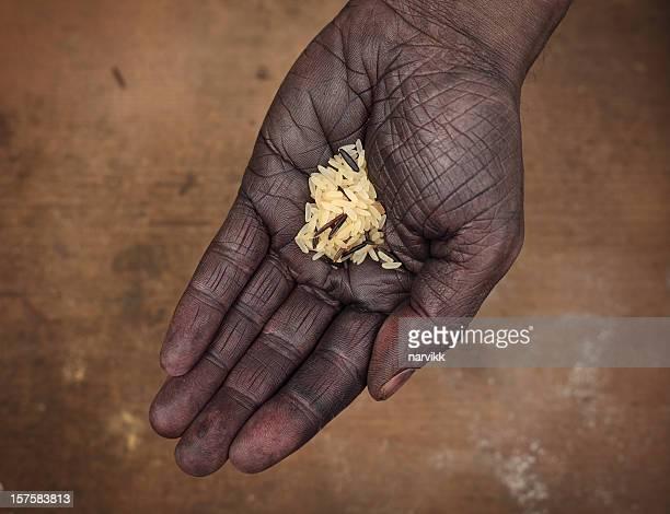 Dark Hand Holding Rice