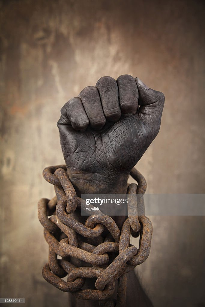 Dark Hand in Heavy Chains : Stock Photo