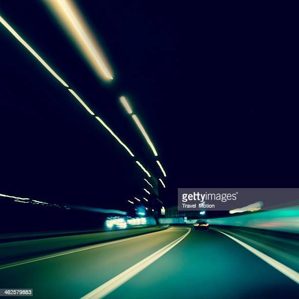 Dark highway at night, with streaks of light