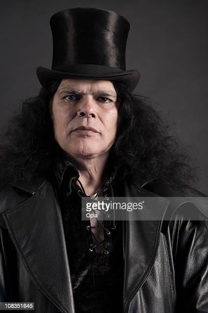 Dark man with top hat