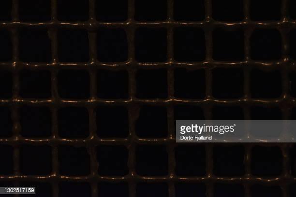 dark metallic grid pattern - dorte fjalland fotografías e imágenes de stock