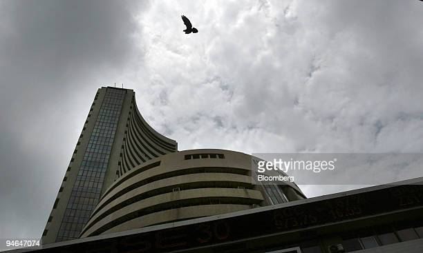 Dark monsoon clouds are seen over the Bombay Stock Exchange building in Mumbai India on Thursday Aug 16 2007 Asian stocks tumbled set for their...