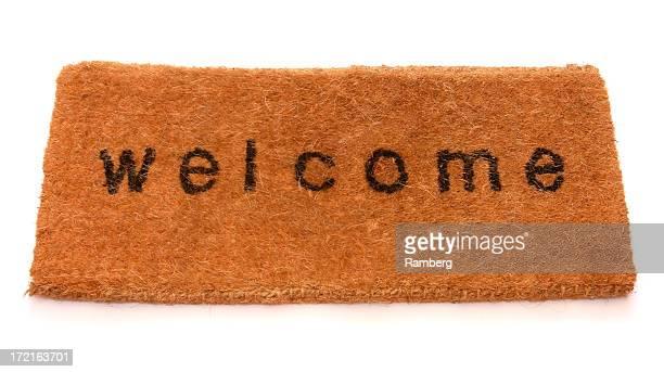 Dark mustard hued, fuzzy welcome front mat