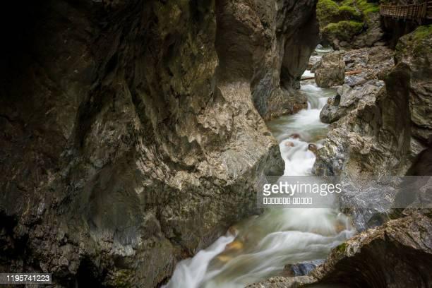 dark narrow rocks cavern in liechtensteinklamm , liechtenstein gorge , austrian alps - austria - liechtenstein stockfoto's en -beelden