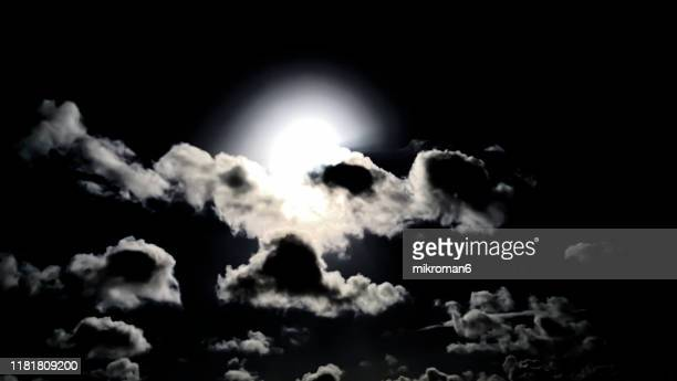 dark night sky with a full moon shining bright as clouds - mystery stock pictures, royalty-free photos & images