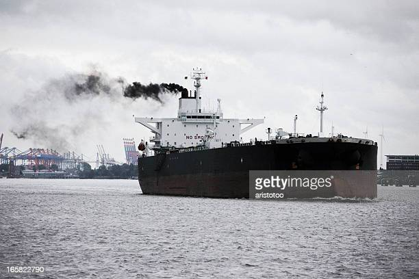 dark oil tanker ship with smoke trail - ship funnel stock photos and pictures