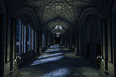 Dark Palace Hallway with lit candles and moonlight shining through the windows, 3d render.