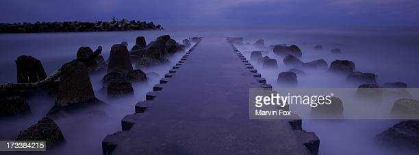 a dark pier - yonago stock pictures, royalty-free photos & images