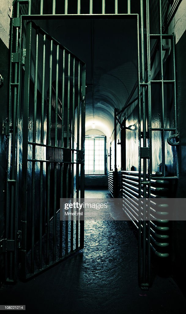 Dark Prison Corridor with Light at End : Stock Photo