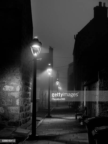 dark public street lights in fog, footdee, aberdeen - sherlock holmes stock pictures, royalty-free photos & images