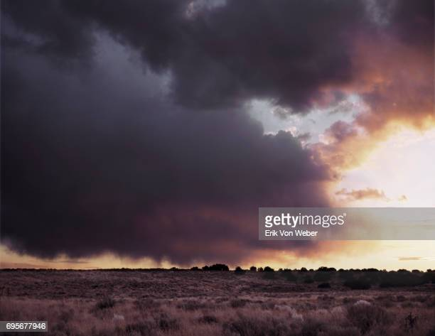 dark rainclouds over desert landscape