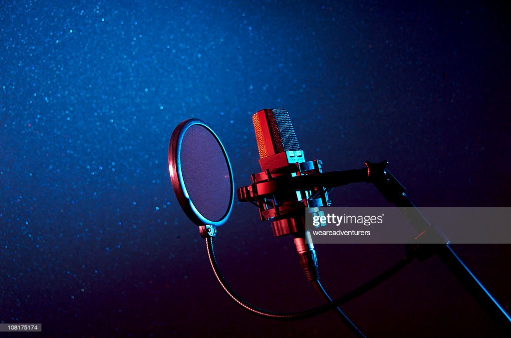 A dark recording studio with a microphone : Stock Photo