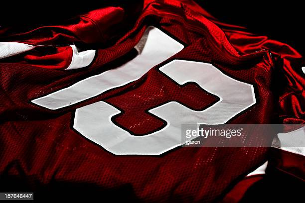 dark red and white jersey with the number thirteen on it - american football strip stock pictures, royalty-free photos & images