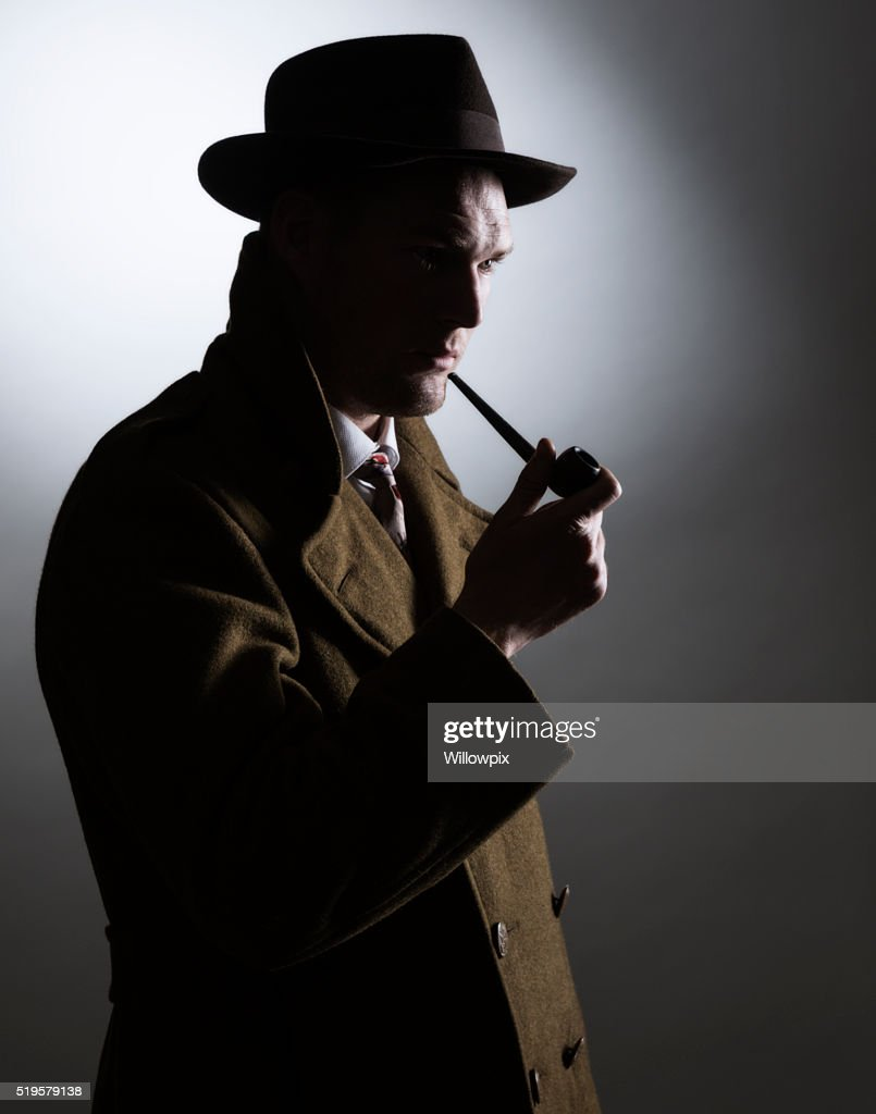 Dark Silhouette 1940s Gumshoe Private Eye Detective Holding Smoking Pipe : Stock Photo
