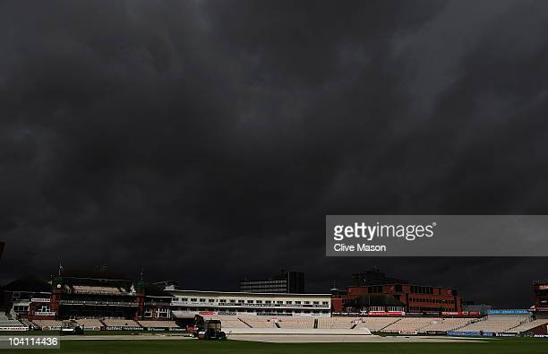 Dark skies above Old Trafford as the covers remain on during day three of the LV County Championship match between Lancashire and Nottinghamshire at...