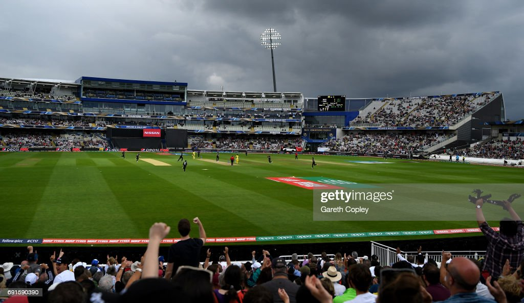 Dark skies approach as Adam Milne of New Zealand dismisses Aaron Finch of Australia during the ICC Champions Trophy match between Australia and New Zealand at Edgbaston on June 2, 2017 in Birmingham, England.
