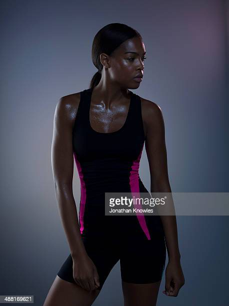 Dark skinned athletic female, post workout, sweaty