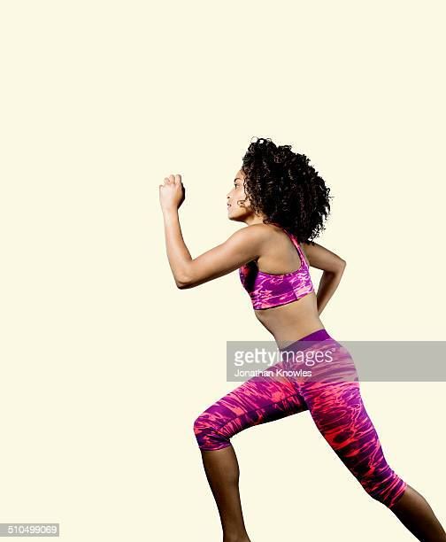 dark skinned athletic female running, profile - pink pants stock pictures, royalty-free photos & images