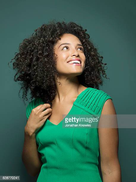 dark skinned female, looking up, smiling - waist up stock pictures, royalty-free photos & images