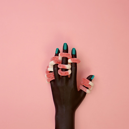Dark skinned hand wearing gel candy rings - gettyimageskorea