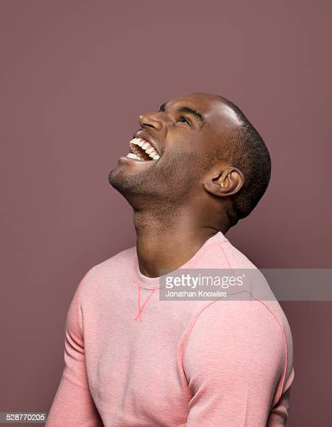 dark skinned looking up, laughing - beautiful people stock pictures, royalty-free photos & images