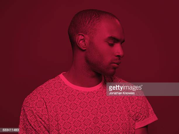 dark skinned male looking down - toned image stock pictures, royalty-free photos & images