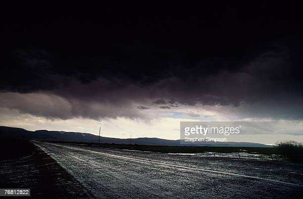 Dark sky above wet highway