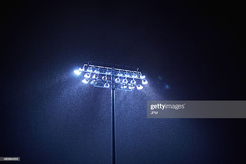 Dark sky and floodlight in rain : Stock Photo