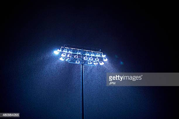 Dark sky and floodlight in rain