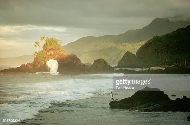 dark sky over jagged samoa coastline - american samoa stock pictures, royalty-free photos & images