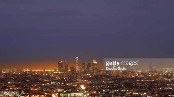 dark sky over the los angeles downtown city skyline - carson california stock pictures, royalty-free photos & images