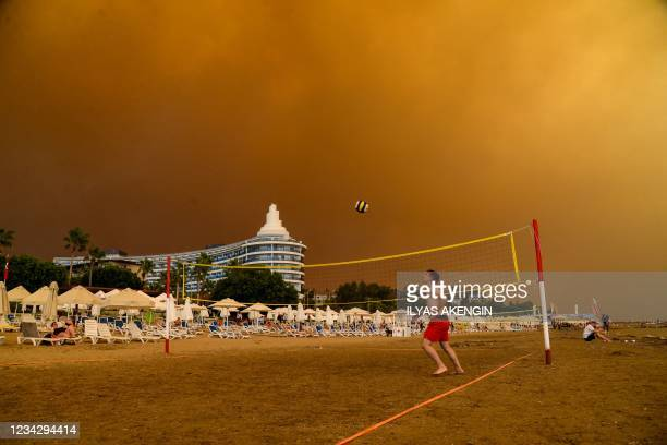 Dark smoke drifts over a hotel complex during a massive forest fire which engulfed a Mediterranean resort region on Turkey's southern coast near the...