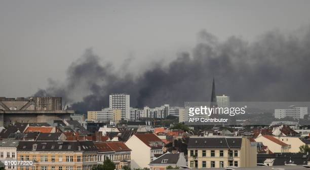 Dark smoke hangs over the Schanzenviertel district on July 7 2017 in Hamburg northern Germany where leaders of the world's top economies gather for a...