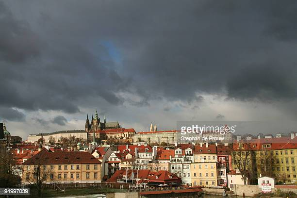 dark snow clouds are gathering over prague - stephan de prouw stock pictures, royalty-free photos & images