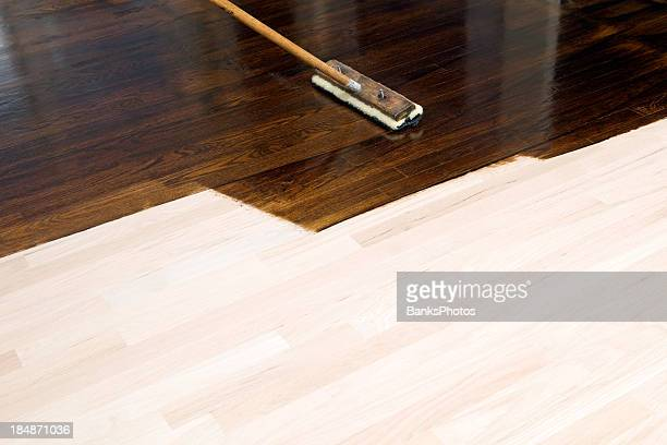 dark stain application on new oak hardwood floor - floorboard stock photos and pictures