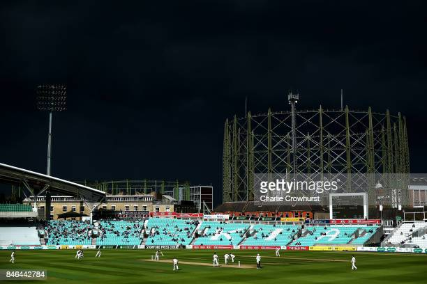 A dark storm cloud passes by during day two of the Specsavers County Championship Division One match between Surrey and Yorkshire at The Kia Oval on...
