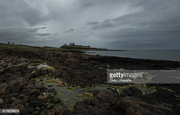 Dark storm clouds form over Dunstanburgh Castle on the coast of Northumberland on September 28 2016 in Craster England Dunstanburgh Castle is a...
