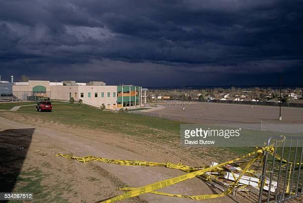 Dark storm clouds gather over Columbine High School just one month after the tragic shootings In May of 1999 students Eric Harris and Dylan Klebold...