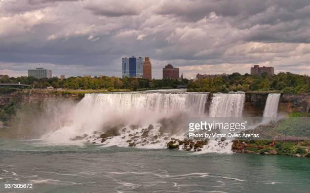 Dark storm clouds over the American Falls and Niagara Falls city, New York, USA