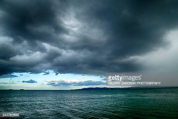 Dark stormy sunset and clouds at sea
