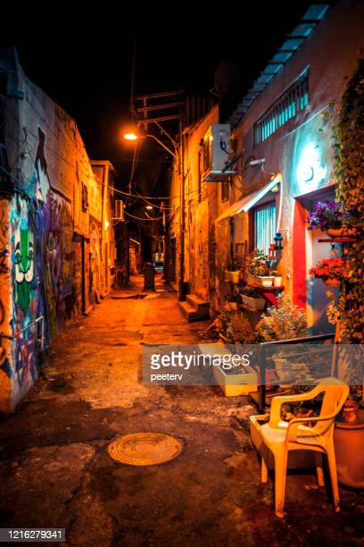 "dark street - florentin district, tel aviv, israel - ""peeter viisimaa"" or peeterv stock pictures, royalty-free photos & images"