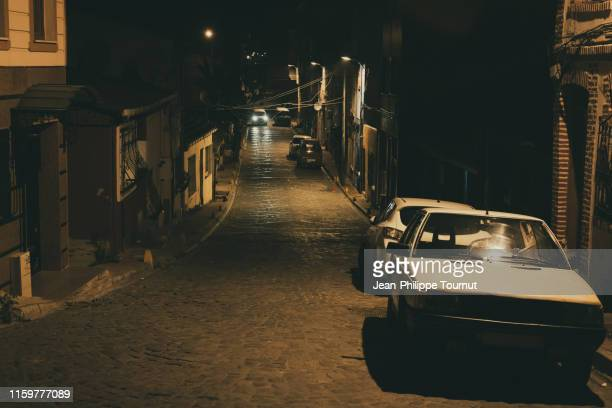 dark street in a residential district of istanbul, turkey - cross processed stock pictures, royalty-free photos & images