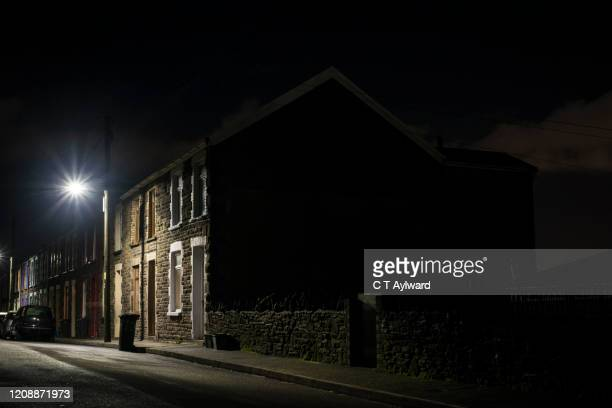 dark streets of a south wales valley community - city life stock pictures, royalty-free photos & images
