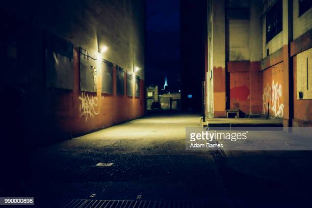 dark streets - alley stock pictures, royalty-free photos & images