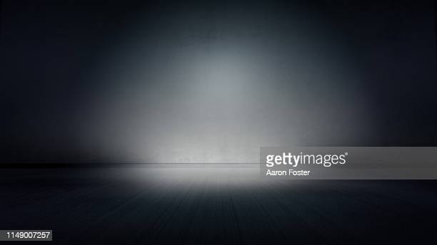 dark studio background - backdrop artificial scene stock pictures, royalty-free photos & images