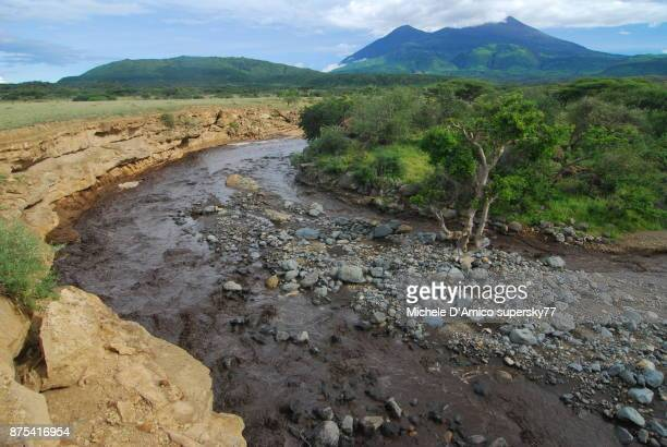 dark termporary stream swollen by strong rainfall - mount meru stock photos and pictures